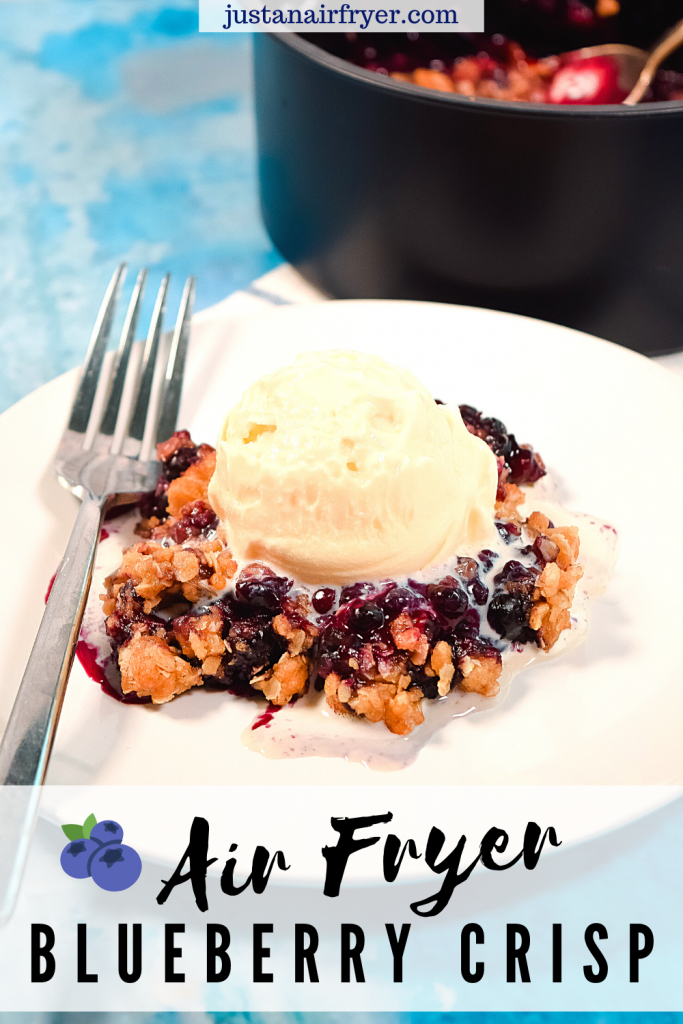 Title image for blueberry crisp in the air fryer with a slice of blueberry crisp topped with vanilla ice cream on a white plate.