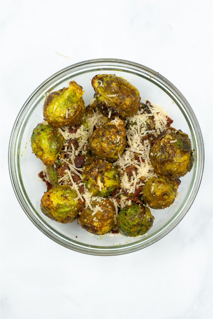 Finished glass bowl of bacon parmesan air fryer brussel sprouts